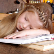 Girl sleep at books — Stock Photo