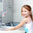 Little girl washing with soap in bathroom — Stock Photo