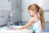 Little girl washing in bathroom — Stock Photo