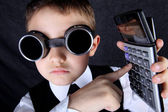 Hard time in learning - boy with calculator — Stock Photo