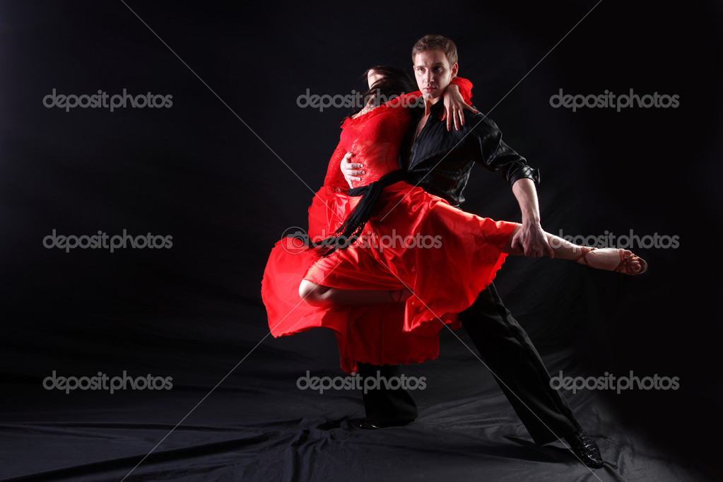 Dancers in action against black background — Stok fotoğraf #4526914