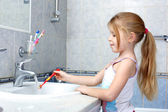 Little girl with toothbrush in the bathroom — Stock Photo