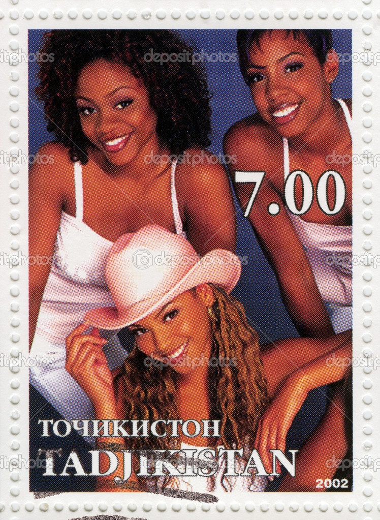 Stamp printed in Tadjikistan with shows american American R&B girl group Destiny s Child, circa 2002 — Stock Photo #4554388