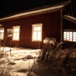 Stock Photo: Classic Red wooden Finnish house in winter covered with snow in
