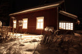 Classic Red wooden Finnish house in winter covered with snow in — Stock Photo