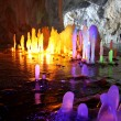 Amazing stalagmite illuminations with help candels and flash in — Stock Photo #4650592