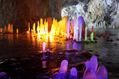 Amazing stalagmite illuminations with help candels and flash in — Stock Photo