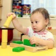 Baby playing with blocks — Stock Photo