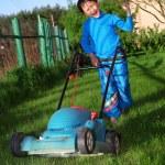 Funny kid lawn mower — Stock Photo