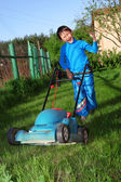Funny kid lawn mower — Stock Photo