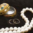 White pearls and wedding rings — Stock Photo #4991846