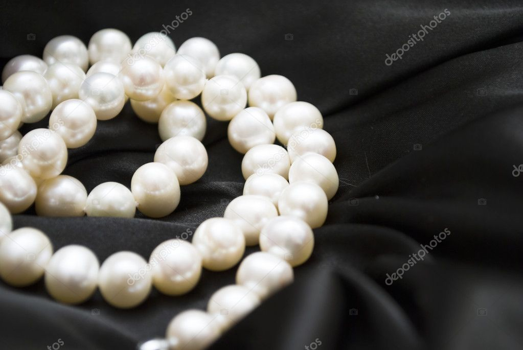 White pearls on the black silk can use as background   Photo #4991913
