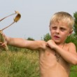 Boy with a slingshot. — Stock Photo