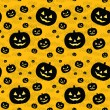 Seamless pattern with black pumpkins — Stockvectorbeeld