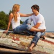 Young couple on old boat — Stock Photo