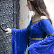 Royalty-Free Stock Photo: Medieval girl opening door