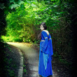 Royalty-Free Stock Photo: Princess walk through darkest forest