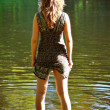 Stock Photo: Girl stand in river