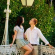 Stock Photo: Couple in park under old streetlamp
