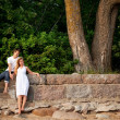 Royalty-Free Stock Photo: Couple stand next stonewall in forest