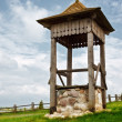 Village well on green hill - Stock Photo
