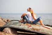 Couple sitting on old boat — Stock Photo