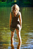 Girl stand in river — Stock Photo