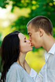 Kissing couple in the park — Stock Photo