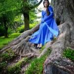 Elf princess in roots of big tree — Stock Photo