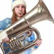 Funny santa girl playing trumpet — Stock Photo