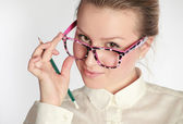 Teacher in funny eyeglasses — Stockfoto