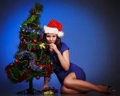 Girl lay near christmas tree — Stock Photo