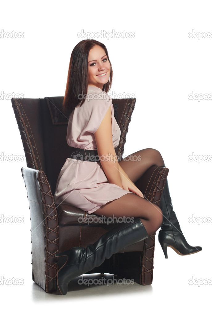 Beautiful girl sitting on chair, isolated on white — Stock Photo #4666560