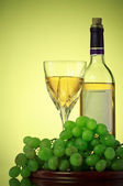 Bottle and glass of wine, grape bunch — Stock Photo