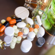 Stock Photo: Different colorful pills and medicines on a mirror surface