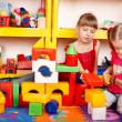Child with puzzle, block and construction set in play room. — Stock Photo #3932619