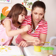 Child painting with teacher in preschool. — Stock Photo #3932628