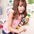 Child with block and construction set in play room. — Stock Photo