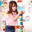Stock Photo: Child preschooler play construction set.