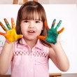Kid making handprints with paint. — Stock Photo #3932657