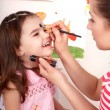 Child preschooler with face painting. - Stock Photo