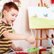 Child paint picture in preschool. — Stock Photo