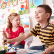 Stock Photo: Children painting in art class.