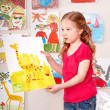 Serious child paint picture. — Stock Photo