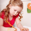 Child with colour pencil draw in preschool. — Stock Photo