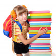 Stock Photo: Schoolgirl with backpack holding pile of books.