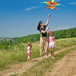 Happy family and children fly kite. Summer. — Stock Photo