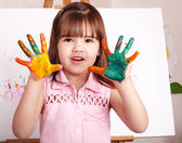 Kid making handprints with paint. — Stock Photo