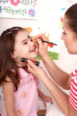 Child preschooler with face painting. — Stock Photo