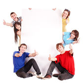 Grupo con thums up y banner. — Foto de Stock